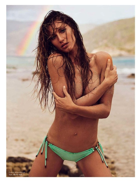 Gisele Bundchen is topless wearing a bikini in Vogue Paris